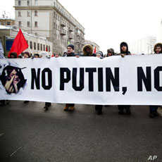 Protesters walk with anti-Putin banner in mass opposition march in central Moscow, February 4, 2012.
