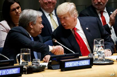 """United Nations Secretary General Antonio Guterres, left, shakes hands with President Donald Trump during the """"Global Call to Action on the World Drug Problem"""" at the United Nations General Assembly, Monday, Sept. 24, 2018, at U.N. Headquarters."""