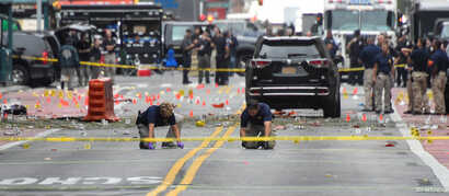 Federal Bureau of Investigation (FBI) officials mark the ground near the site of an explosion in the Chelsea neighborhood of Manhattan, New York, Sept. 18, 2016.
