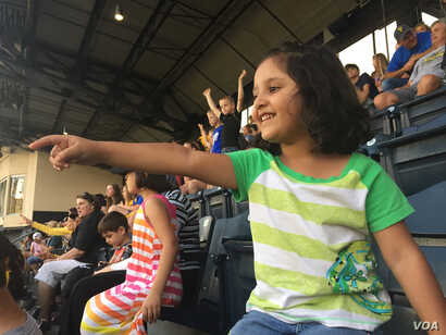 In Afghanistan, people are big fans of soccer not baseball, Kazam Hashimi said, while his children, ages 6, 5 and 3, enjoy their first Major League Baseball game in PNC Park, Aug. 1, 2017, in Pittsburgh, Penn.
