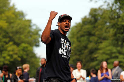 """Marques Armstrong chants in support of Philando Castile, who was fatally shot by Minneapolis area police during a traffic stop on Wednesday, at a """"Black Lives Matter"""" demonstration, in front of the Governor's Mansion in St. Paul, Minnesota. (Reuters)..."""