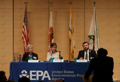 The U.S. Environmental Protection Agency's Deborah Jordan, seated from left, Preston Cory and Aaron Ringel listen to a speaker at an Environmental Protection Agency listening session in San Francisco, Feb. 28, 2018.