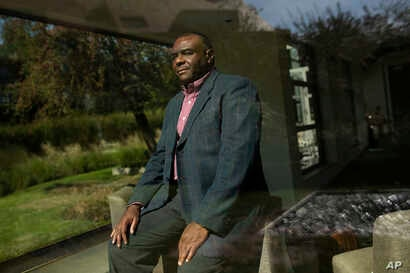 Former Congolese Vice President Jean-Pierre Bemba poses for a photograph after being interviewed by The Associated Press in Waterloo, Belgium, Sept. 11, 2018.