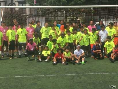 DC Scores group photo commemorating another day of soccer camp. (Photo by J. Nazar/VOA)
