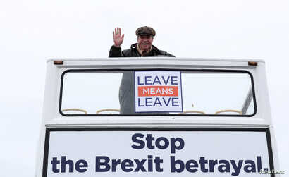 "Brexit campaigner Nigel Farage gestures during a ""Brexit Betrayal"" march from Sunderland to London, in Sunderland, Britain, March 16, 2019."