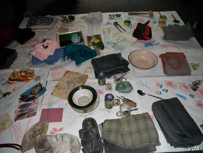 Belongings of a war victim is displayed during a Memory Box workshop in Kabul Afghanistan. (Photo: Afghanistan Human Rights and Democracy Organization)