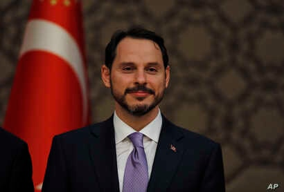 Berat Albayrak, Turkey's newly appointed Finance Minister, listens to President Erdogan as he  presents his new cabinet during a news conference at Presidential Palace, in Ankara, Turkey,  July 9, 2018.