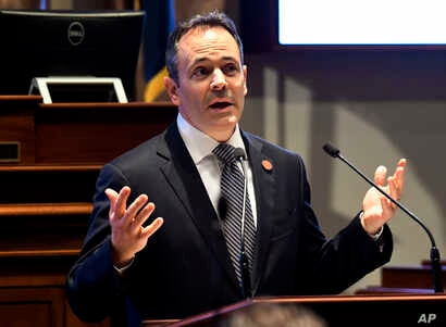 FILE - Kentucky Gov. Matt Bevin speaks to a joint session of the General Assembly at the Capitol, in Frankfort, Ky., Jan. 16, 2018. Bevin has won an initial round in his court fight over whether he violated free-speech rights by blocking people from ...