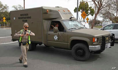 A sheriff's hostage negotiation team passes a California highway patrol checkpoint at the Veterans Home of California in Yountville, California, March 9, 2018.