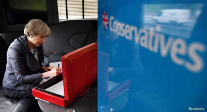 Britain's Prime Minister Theresa May works on her campaign bus as it travels through Staffordshire, June 6, 2017.
