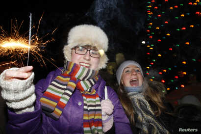 FILE - People celebrate New Year's Day in the arctic town of Vorkuta, 2,268 km (1,409 miles) northeast of Moscow, Jan. 1, 2010.