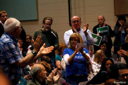 Voters react to a question from the audience to U.S. Representative Leonard Lance, R-NJ, during a town hall meeting with constituents in Cranford, New Jersey, May 30, 2017.