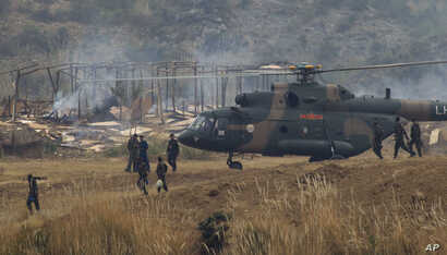 FILE - Chinese and Pakistani troops take part in a joint war exercie in Jhelum, Pakistan, Nov. 24, 2011.