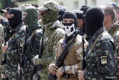 "Members of the ""Donbas Battalion"" take part in a swearing in ceremony near Kyiv, June 23, 2014."