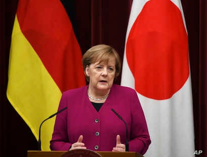 German Chancellor Angela Merkel answers a question during a joint press conference with Japanese Prime Minister Shinzo Abe following their summit meeting at Abe's official residence in Tokyo, Feb. 4, 2019.