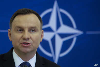 Polish President Andrzej Duda briefs the media, Nov. 28, 2016, after a joint visit with German President Joachim Gauck. On Wednesday, Dec. 14, 2016, Duda was urged to veto a freedom of assembly bill by human rights groups.