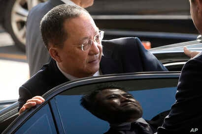 """FILE - North Korean Foreign Minister Ri Yong Ho gets into a car at Beijing Capital International Airport in Beijing, Sept. 19, 2017. In New York the next day, Ri described as """"the sound of a dog barking"""" U.S President Donald Trump's threat to destroy..."""