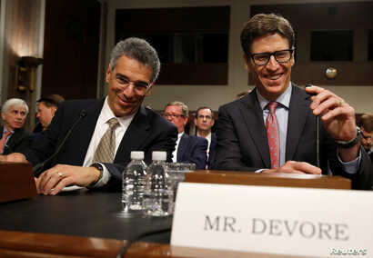 Leonard Cali, senior vice president for global public policy at AT&T Inc., and Andrew DeVore, vice president and associate general counsel at Amazon.com Inc., speak before testifying before the Senate Commerce, Science and Transportation Committee on...