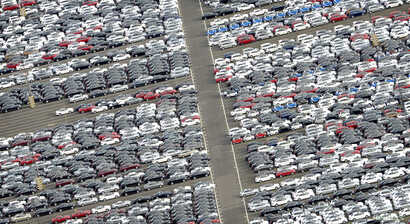 FILE - Cars for export stand in a parking area at a shipping terminal in the harbor of the northern German town of Bremerhaven, October 8, 2012.