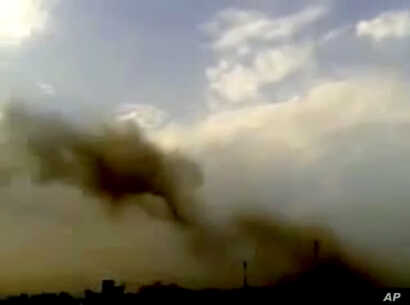 This image taken from video obtained from the Shaam News Network purports to show smoke rising from buildings following a huge explosion in Saadallah al-Jabri Square in Aleppo, Syria, October 3, 2012.