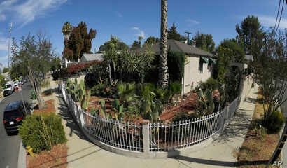 This photo shows the corner of Robert Chain's house in the Encino section of Los Angeles, Aug. 30, 2018. Chain, who was upset about The Boston Globe's coordinated editorial response to President Donald Trump's attacks on the news media, was arrested ...