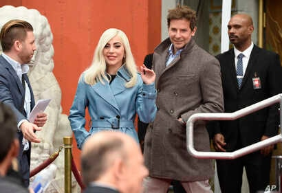 """Lady Gaga, left, and Bradley Cooper, co-star's in """"A Star Is Born,"""" attend a hand and footprint ceremony honoring actor Sam Elliott at the TCL Chinese Theatre, Jan. 7, 2019, in Los Angeles."""