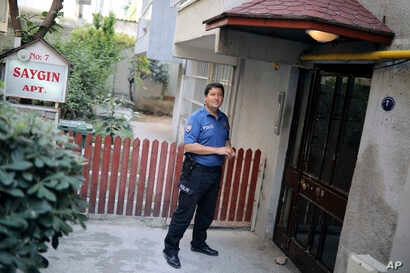 A Turkish police officer stands outside the house of American Pastor Andrew Craig Brunson, a 50-year-old evangelical pastor from Black Mountain, North Carolina, before his arrival, in Izmir, Turkey, July 25, 2018 after his release from a jail near Iz...