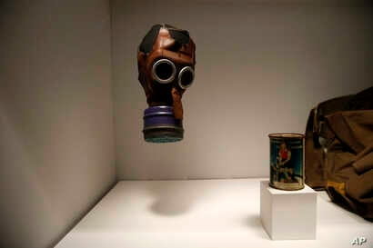 """A child's gas mask is part of the permanent exhibit """"Salute to the Home Front"""" at the National World War II Museum which will open to the public in New Orleans, June 5, 2017."""