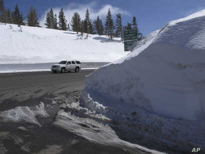 This photograph taken March 26, 2017, shows the record snow piled at the summit of the Mount Rose Highway (Nevada State Route 431) near the Mount Rose ski resort half way between Reno and Lake Tahoe. At an elevation of 8,911 feet, it is the highest h...