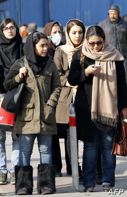Iranian women wearing hijab walk down a street in the capital Tehran, Feb. 7, 2018. A spate of protests against Iran's mandatory headscarves for women have been few but have reignited a debate that has preoccupied the Islamic republic since its found...