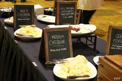 At the gala event to announce the winner at the U.S. Cheese Championship, ticket-holders got to sample dozens of cheeses, including the always-popular cheddar, in Green Bay, Wis., March 7, 2019.