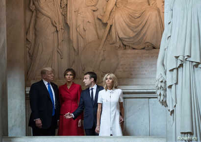 U.S. President Donald Trump and first lady Melania Trump, French President Emmanuel Macron, and his wife Brigitte Macron tour Napoleon Bonaparte's Tomb at Les Invalides in Paris, France, July 13, 2017.