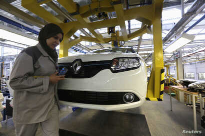 FILE - A female employee works in a Renault factory in Oran, west of Algiers, Nov. 10, 2014.