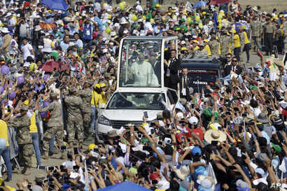 Pope Francis waves from his pope mobile as arrives to celebrate Mass on Huanchaco Beach, near the city of Trujillo, Peru, Jan. 20, 2018.