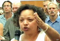 Community activist Vernice Miller-Travis raises concerns over development issues in the Chesapeake Bay watershed at a crowded town hall meeting in Annapolis, Maryland