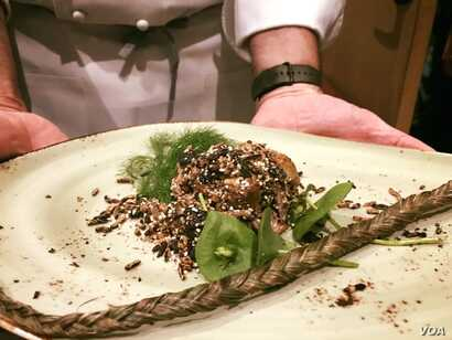 Sean Sherman prepared this modern version of a traditional Lakota dish, Wasna, made with duck, popped wild rice and amaranth, foraged fennel and miners lettuce at the 20th annual World of Flavors at the Culinary Institute of America, St. Helena, Ca.,...