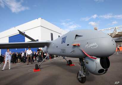 FILE - With the signature of the nation's founding father Kemal Ataturk on its front,Turkey's first drone airplane called Anka or Phoenix is seen during a roll out ceremony at the TAI - Turkish Aerospace Space Industries Inc., near Ankara, Turkey, Ju...