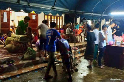 Villagers are seen inside a temporary shelter with their belonging as they evacuate after the Xepian-Xe Nam Noy hydropower dam collapsed in Attapeu province, Laos, July 24, 2018.