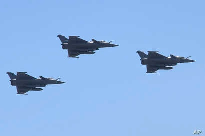 FILE - Three French made Rafale fighter jets fly in formation above Cairo, July 21, 2015.
