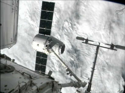 This image from NASA-TV shows the capture of the Dragon capsule by a robot arm on the International Space Station as they passed over the South Atlantic Ocean early October 10, 2012.