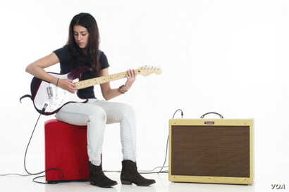 Natasha Meister with her beloved electric guitar, the first woman in Africa to be endorsed by Fender guitars(Courtesy Natasha Meister)