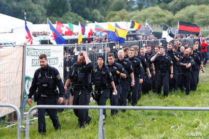 FILE - Police are seen during one of Germany's biggest right-wing music festivals in Themar, Germany, July 15, 2017.