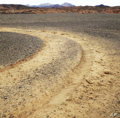 This January 2019 photo provided by the U.S. National Park Service shows vehicle tracks in an area of Death Valley National Park, Calif., that park staff say can leave a lasting trench. National parks across the United States are scrambling to clean ...