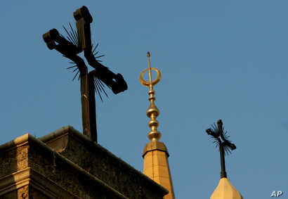 A minaret of the Mohammed al-Amin Mosque and two crosses on top of the Maronite St. George Cathedral are seen in downtown Beirut, Lebanon, Sept. 17, 2006.