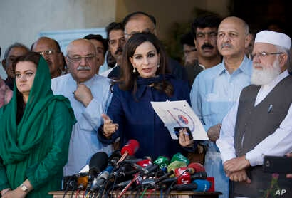 Sherry Rehman, center, briefs members of the media about all parties conference proceedings in Islamabad, Aug. 2, 2018. The All Party Conference (APC) meeting was held by the opposition to devise a strategy to decide a course of action with regards t...