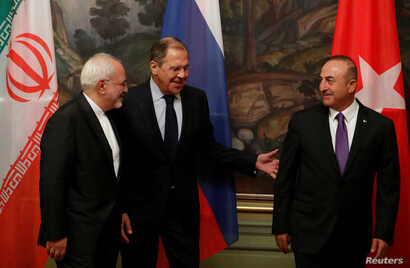 Foreign Ministers Mohammad Javad Zarif of Iran, Sergey Lavrov of Russia and Mevlut Cavusoglu of Turkey gather for a photo following their meeting in Moscow, April 28, 2018.