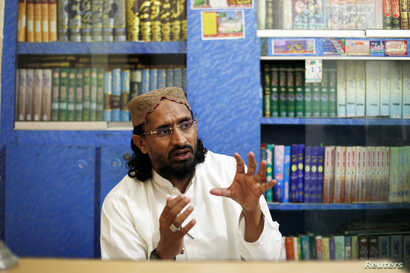FILE - Aurangzeb Farooqi, leader of Ahl-e-Sunnat Wal Jamaat (ASWJ) gestures during an interview with Reuters at his office in Karachi, Feb. 13, 2013.