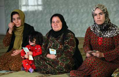 Women and young girls listen to Rasul (not pictured), an Iraqi Kurdish activist with the nonprofit organization WADI, as she speaks about the harms of genital mutilation in Sharboty Saghira, Iraq, Dec. 3, 2018. Female genital mutilation appears to ha...