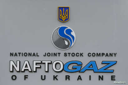 FILE - The logo of the Ukrainian national joint stock company Naftogaz is seen outside the company's headquarters in central Kyiv, March 15, 2016.