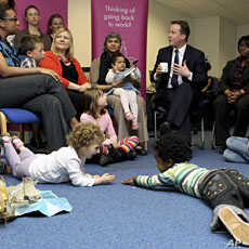 One month before becoming prime minister, Britain's Conservative Party leader David Cameron David Cameron (C) visits the Women Like Us agency in London, which supports mothers looking for flexible work and businesses seeking part-time staff, April 14...